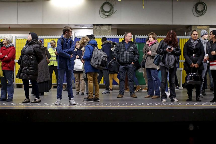 People wait for a subway train at the Central Station stop in Brussels, Belgium.