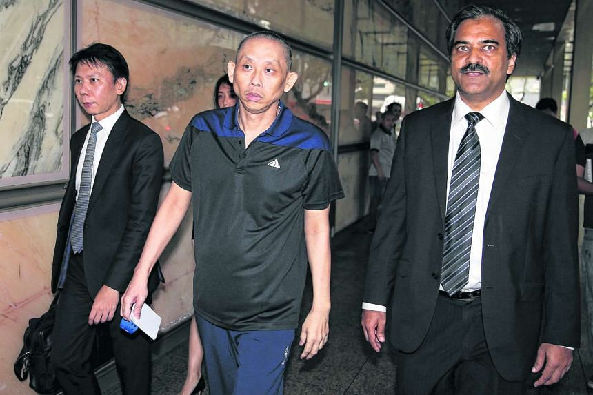 Alleged match-fixing mastermind Dan Tan pictured with his lawyers Thong Chee Kun(left) and Hamidul Haq (right) after being freed yesterday by the Court of Appeal.