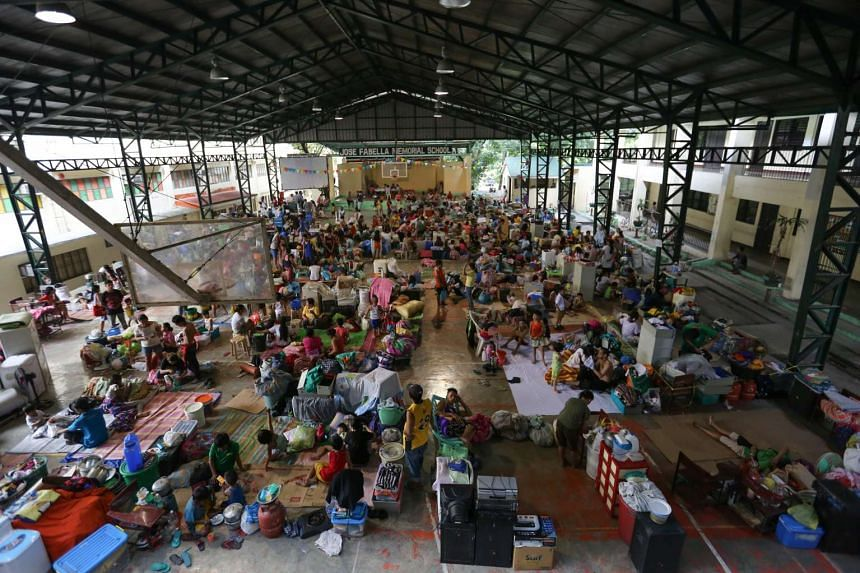 A school's basketball court was turned into an evacuation centre following the fire in Mandaluyong City, east of Manila, Philippines.