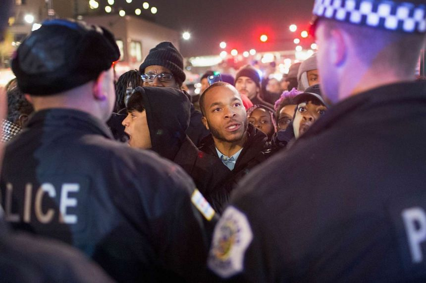 Demonstrators confronting the police during a protest in Chicago on Nov 24.