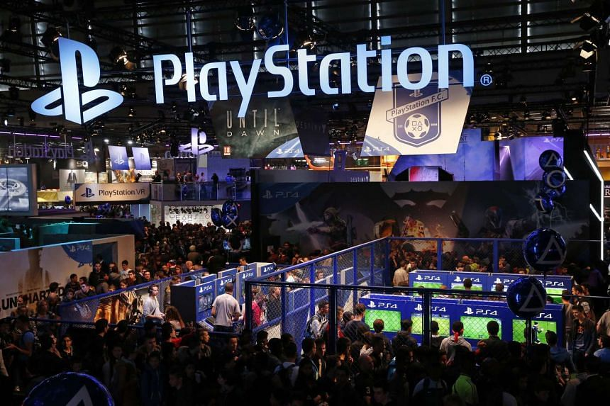 Visitors play games on PlayStation 4 at the Paris Games Week in October 2015.