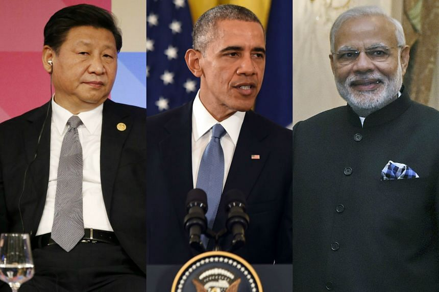 President Barack Obama (centre) will meet China's Xi Jinping (left) and India's Narendra Modi on the opening day of talks in Paris to reach an international climate agreement.