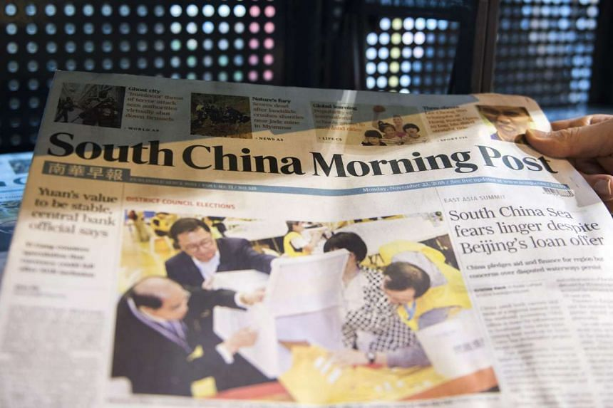 Copies of the South China Morning Post newspaper displayed for sale.