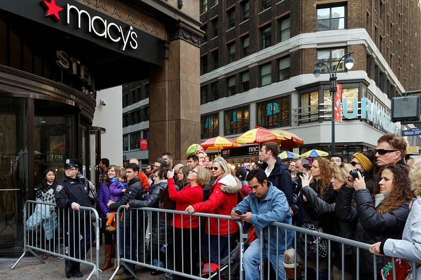 Shoppers wait outside Macy's department store in Herald Square, New York, on Nov 26, 2015.