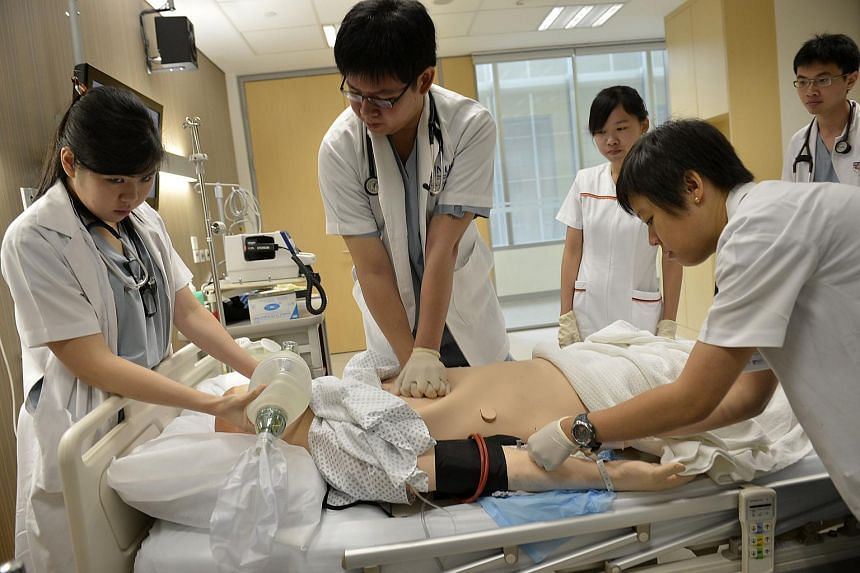 Medical students practise resuscitation techniques on a mannequin at the Centre for Healthcare Simulation.