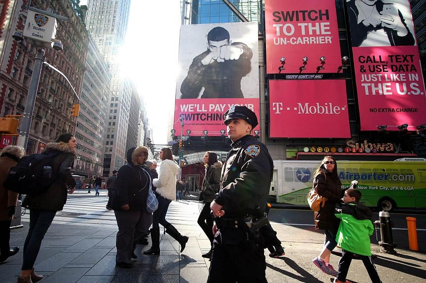 New York police officers patrolling around Times Square on Nov 25.