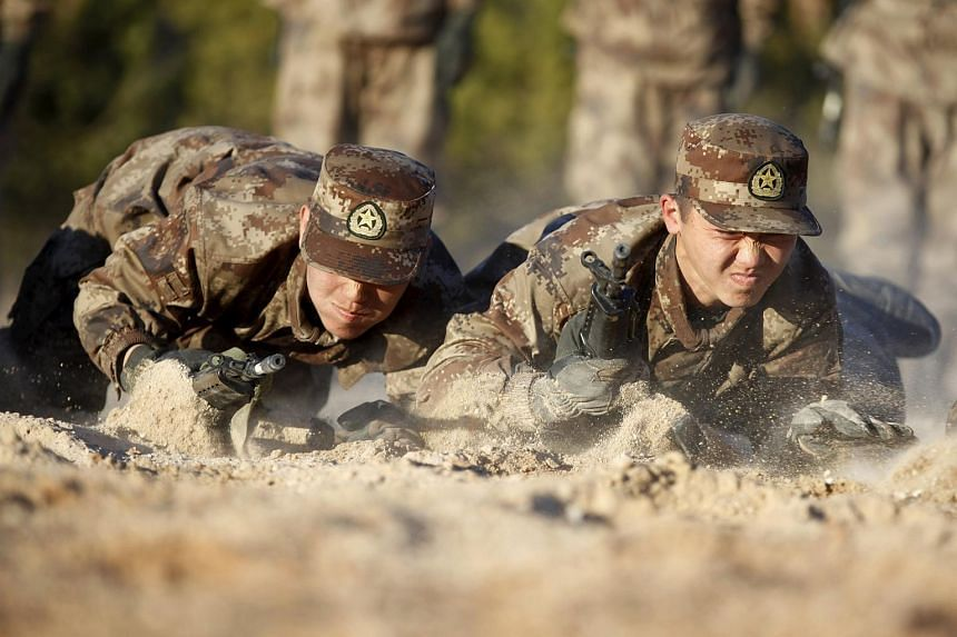 About 200 new recruits of the Chinese army take part in a training in Heihe on Oct 21, 2015.