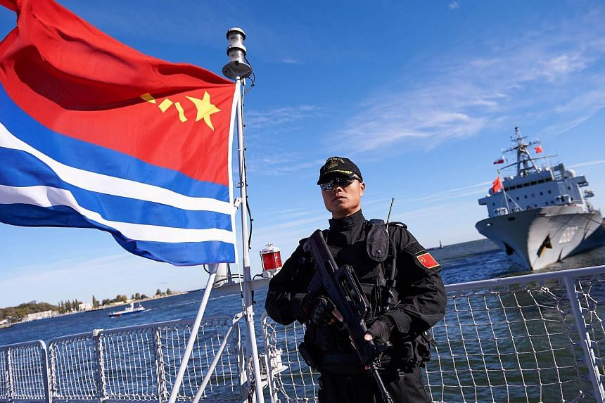 A Chinese soldier on a deck of a Chinese Navy ship in Gdynia, Poland, on Oct 7.