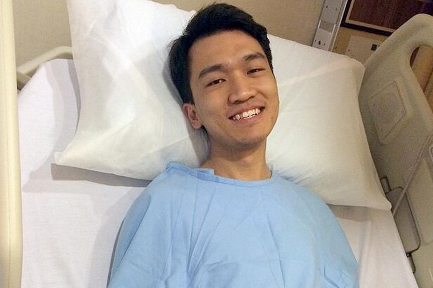 Mr Howard Kuay flashing a brave smile from his hospital bed.