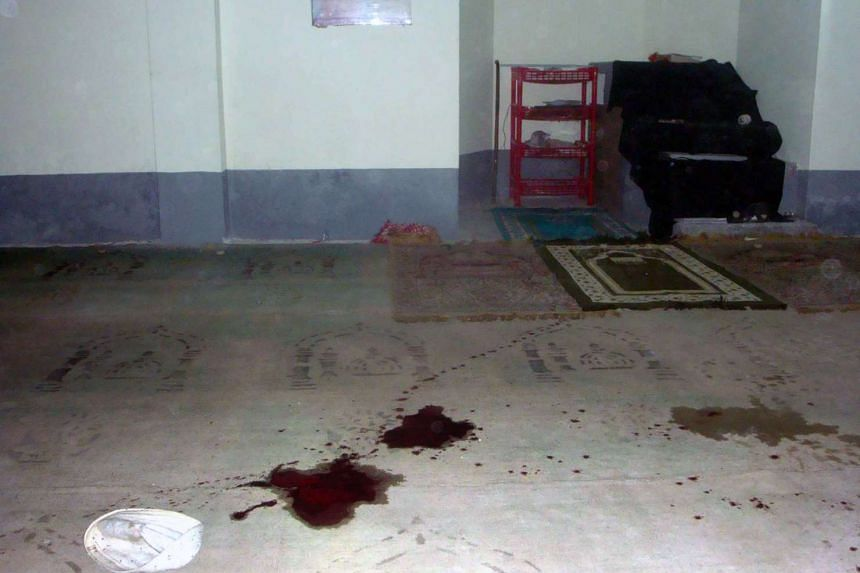 Blood stains are seen on the floor of a Shi'ite mosque after a shooting in northern Bangladesh on Nov 26, 2015.