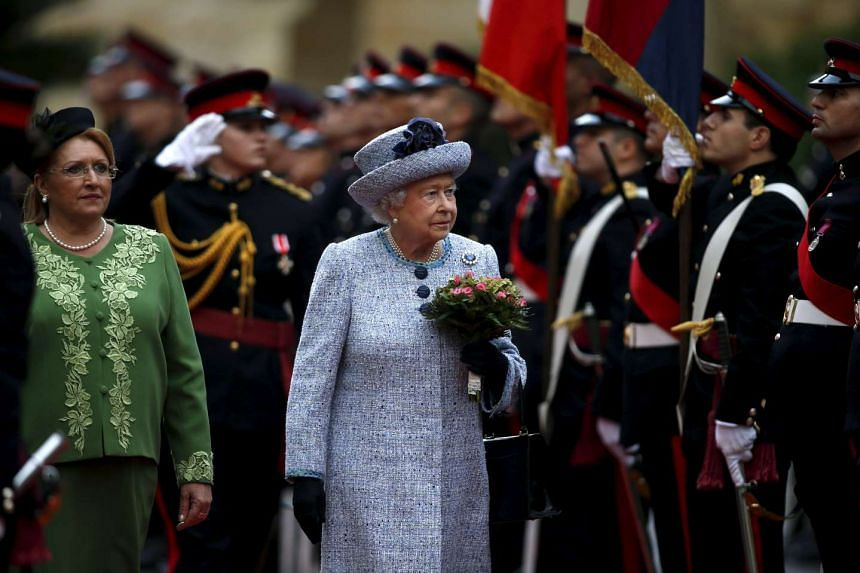 Britain's Queen Elizabeth and Malta's President Marie Lousie Coleiro-Preca (left) inspect a guard of honour at San Anton Palace in Attard, after arriving for the Commonwealth Heads of Government Meeting (CHOGM) in Malta, on Nov 26, 2015.