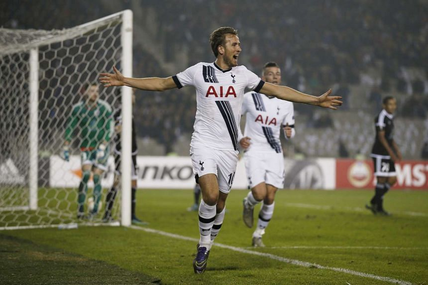 Harry Kane celebrates after scoring the first goal for Tottenham.