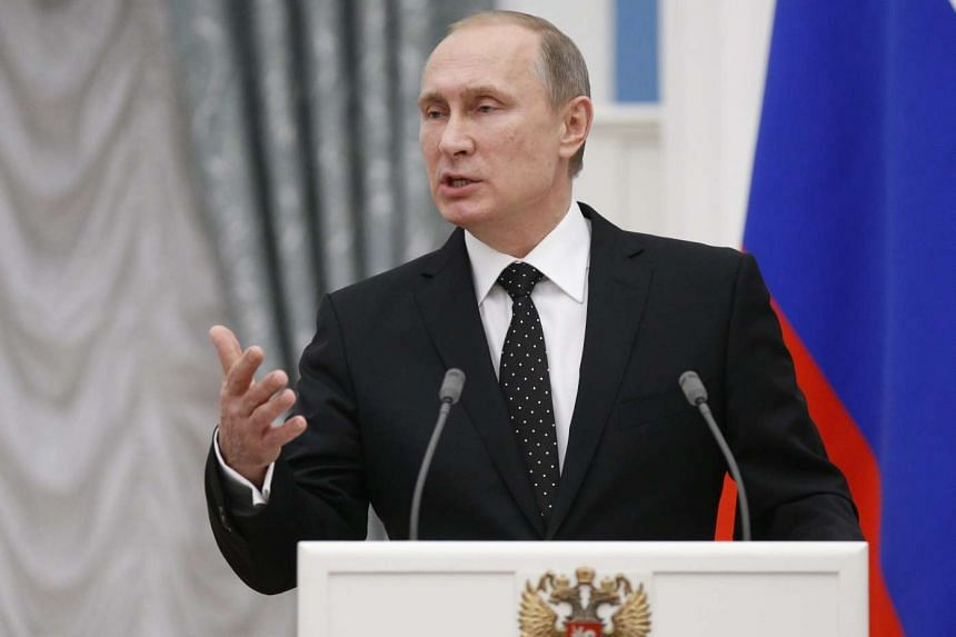 Russian President Vladimir Putin speaks at a joint news conference with his French counterpart Francois Hollande (not pictured) after the meeting in Moscow, Russia, on Nov 26, 2015. French President Francois Hollande is in Moscow to push for a strong