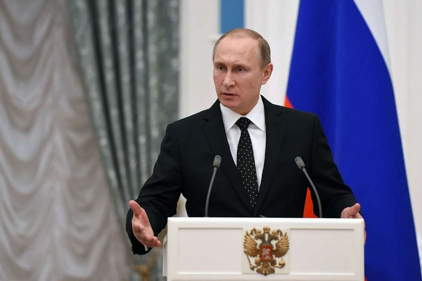 Russian President Vladimir Putin speaking at a press conference with French President Francois Hollande (not seen) following a meeting at the Kremlin on Nov 26.