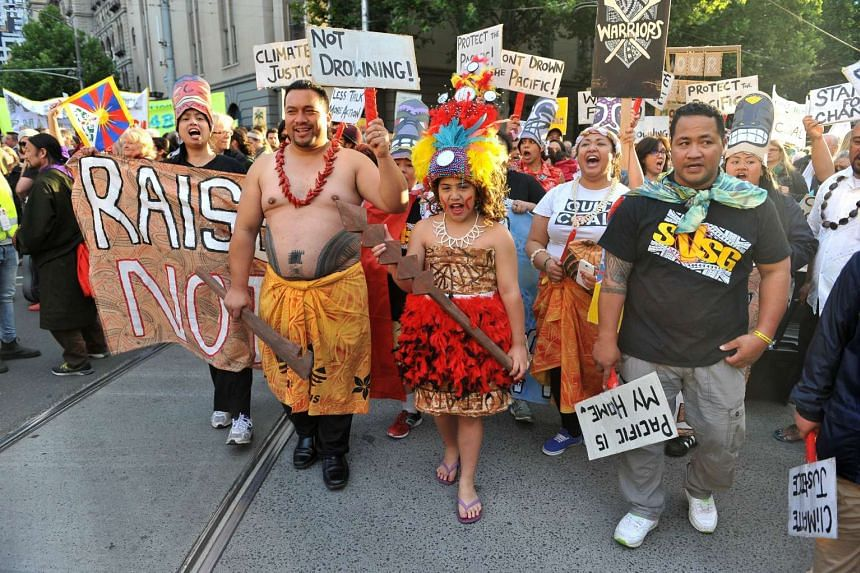 A group of Pacific Islanders attend a climate change rally in Melbourne on Nov 27, 2015.