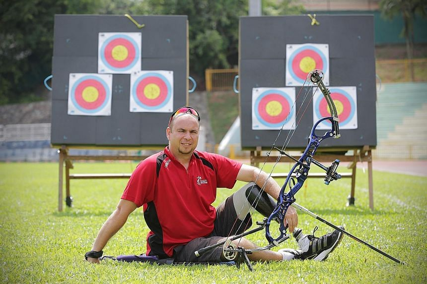Robert Fuchs, 40, at a training session at Queenstown Stadium. He lost his left leg last year when his motorcycle hit a car. He will be competing in the individual and mixed team compound bow events at the APG.