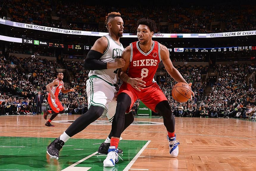 Nineteen-year-old Jahlil Okafor (right) is on a Philadelphia 76ers team who are the youngest in the NBA. The loss to the Boston Celtics puts their record at 0-16, just one defeat away from tying the 0-17 start last season.
