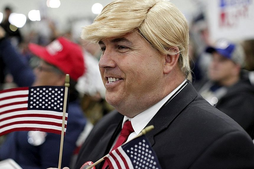 A Donald Trump lookalike showing his support for the Republican front runner at a rally in Myrtle Beach in South Carolina on Tuesday. Mr Trump's campaign has shown great resilience, and he remains atop all major new polls.
