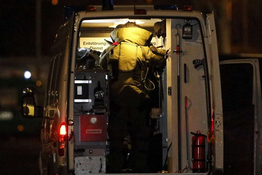 A police bomb disposal officer arrives during a raid on a building in Britz, south Berlin.