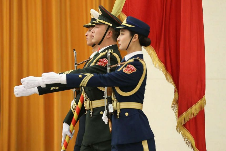 42bab8b70b7 Members of People s Liberation Army honour guards preparing for a welcome  ceremony in Beijing on Nov