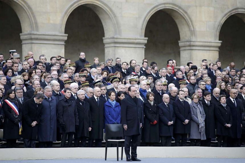 French President Francois Hollande stands during the remembrance ceremony on Nov 27, 2015.