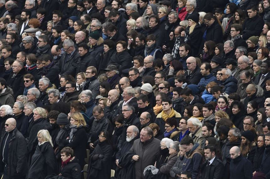 People attend the remembrance ceremony on Nov 27, 2015.
