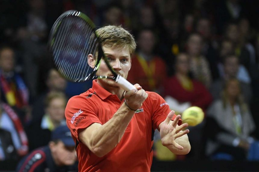 Belgium's David Goffin returns the ball to Britain's Kyle Edmund.