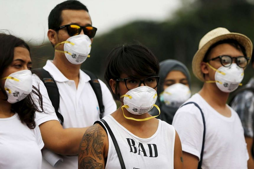 Indonesian environmental activists wearing masks during a protest in Jakarta on Oct 9.