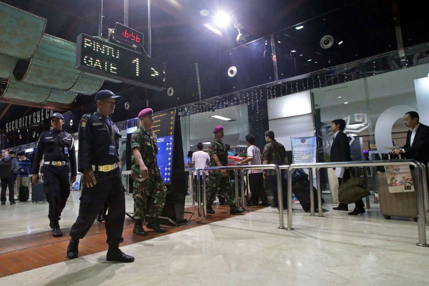 Indonesian security personnel patrolling in the Sukarno Hatta International airport in Cengkareng.