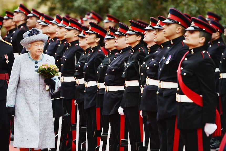 Britain's Queen Elizabeth II inspecting a guard of honour at the San Anton Palace in Malta on Nov 26.