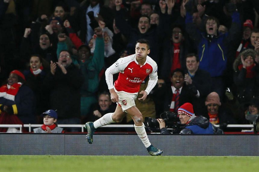 Alexis Sanchez celebrates after scoring the third goal for Arsenal against Dinamo Zagreb on Nov 24, 2015.