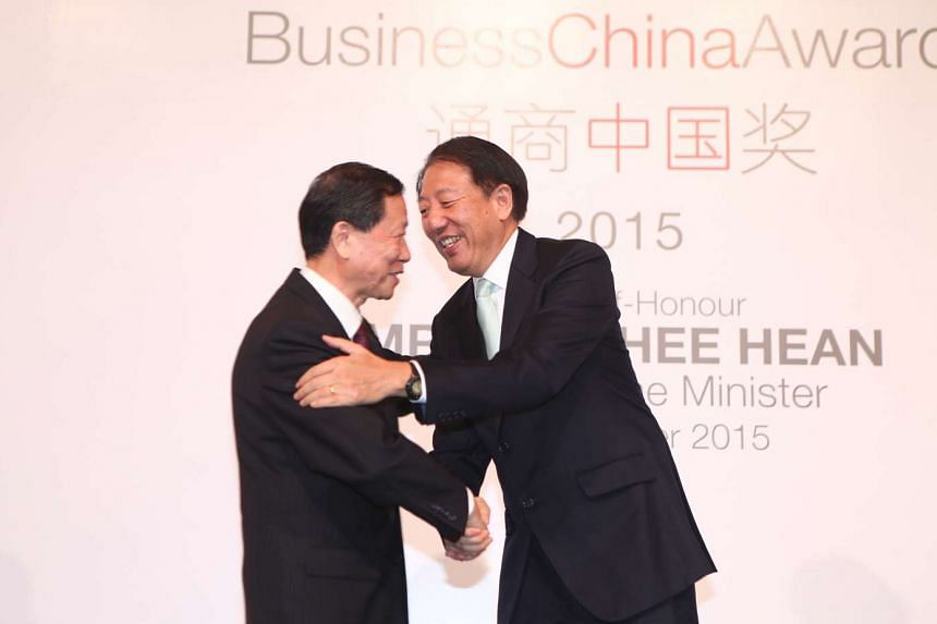 Singapore Deputy Prime Minister Teo Chee Hean (right) congratulates Mr Li Rongrong, 71, the founding chairman of China's State-Owned Assets Supervision and Administration of the State Council, for winning the Business China Award. Mr Li was honoured for b