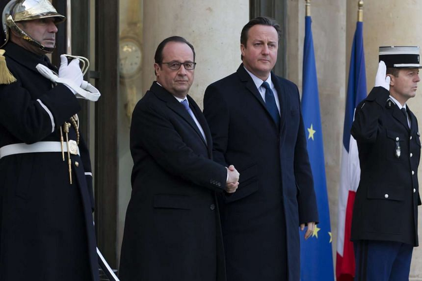 """MONDAY: President Francois Hollande (above, centre left) met British Prime Minister David Cameron to muster support for a """"global fight"""" against the Islamic State in Iraq and Syria. At a joint press conference in Paris, the British PM promised to"""