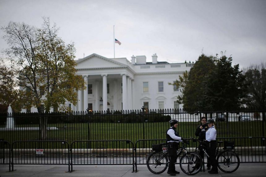 Uniformed US Secret Service officers keep watch outside the White House on Nov 17, 2015.