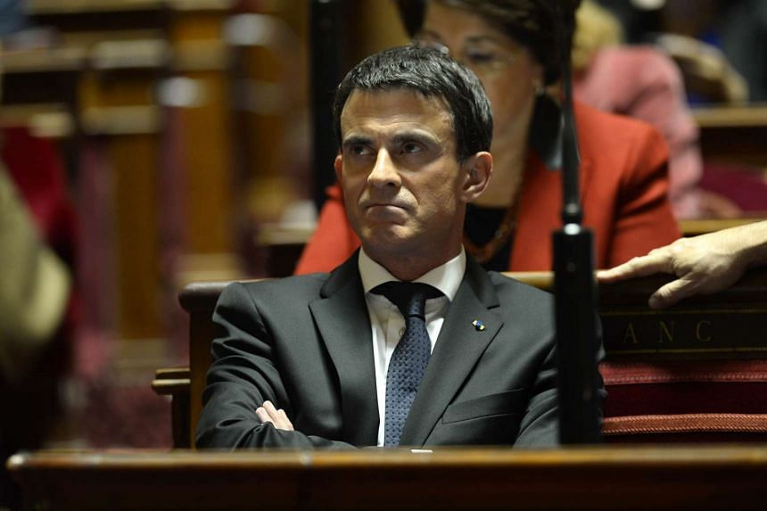 French PM Manuel Valls listening to lawmakers during a debate on the state of emergency at the French Senate on Nov 20, 2015 in Paris.