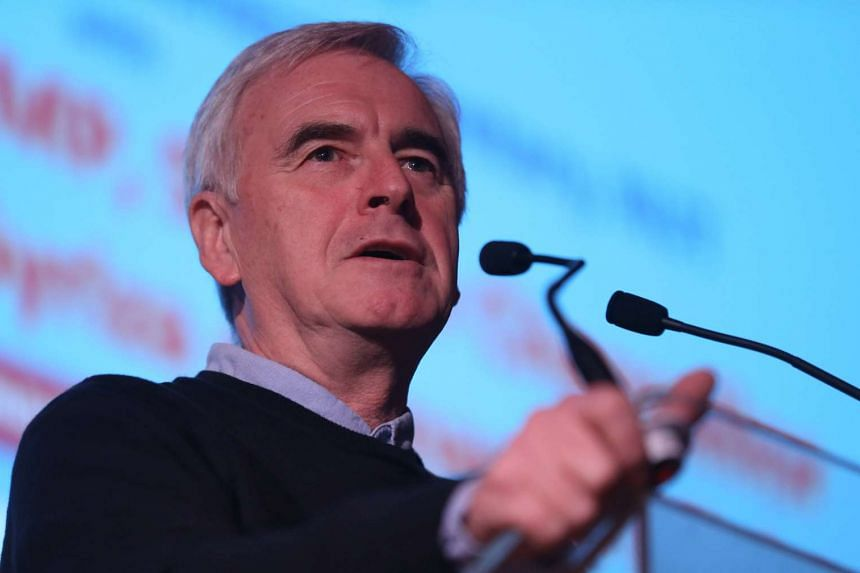 Britain's opposition Labour Party's John McDonnell said lawmakers should be allowed to follow their conscience on issues such as going to war.
