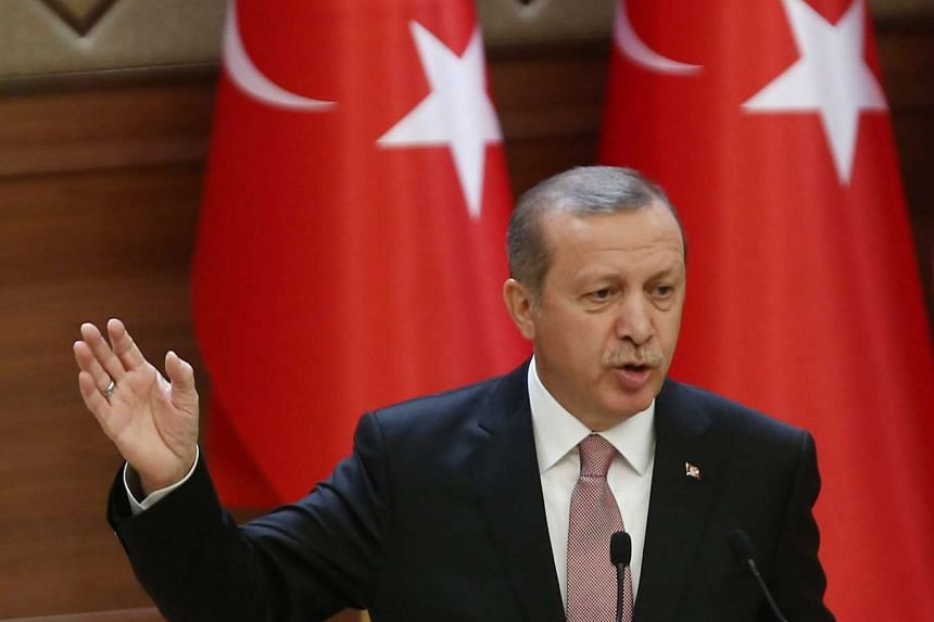 Turkish President Recep Tayyip Erdogan delivers a speech during a mukhtars meeting at the presidential palace on Nov 26, 2015 in Ankara.