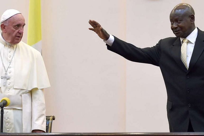 Pope Francis is welcomed by Uganda's president Yoweri Museveni at his arrival at the State House in Entebbe, Uganda, on Nov 27, 2015. Pope Francis is on a six-day African topur that will take him to Kenya, Uganda and the Repulic of Central Africa fro