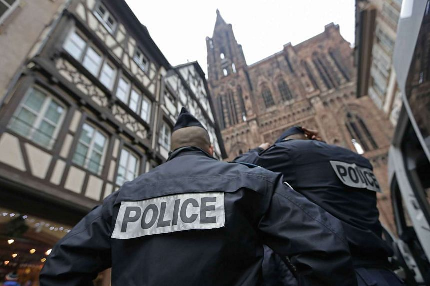 French police officers patrol near the Cathedral of Strasbourg.