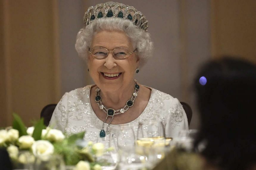 Queen Elizabeth smiles at a dinner at the Corinthia Palace Hotel in Malta on Nov 27, 2015.