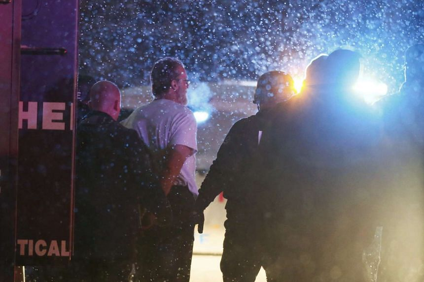 A suspect is taken into custody outside a Planned Parenthood center in Colorado Springs on Nov 27, 2015.