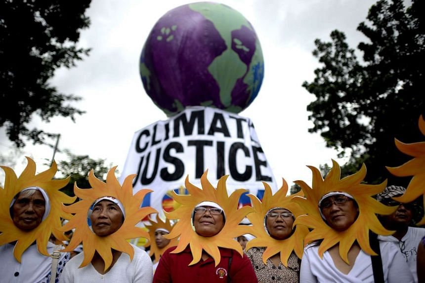 Protesters attend a climate change march on a highway in Manila on Nov 28, 2015.
