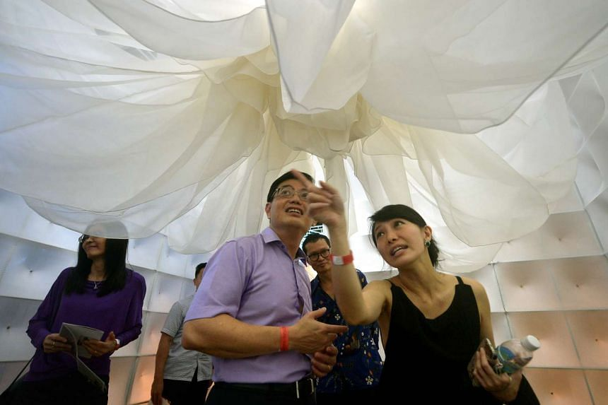 Minister Heng Swee Keat (centre) with artist and fashion designer, Ms Elyn Wong, 39 (right), in her work Beings of the Garment.