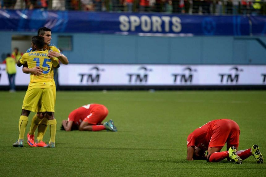 LionsXII and Pahang players reacting at the final whistle.