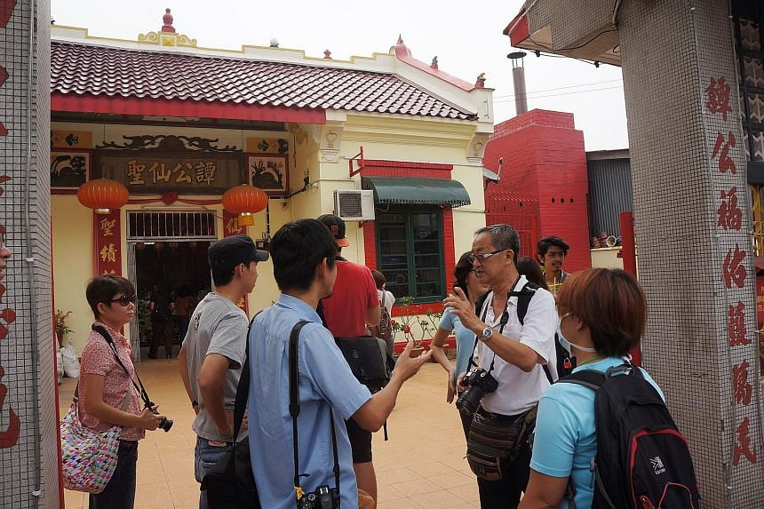Malaysians of all stripes and races joined the walk through Pekan Ampang to learn the history of the place that might be torn down soon to make way for a proposed highway. This old temple was one of the stops.