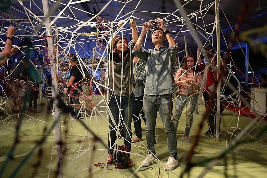 Above: People participating in the art installation by Tay Bee Aye called Draw, Weave, Knot at the carnival at the Padang. Left: Dancers performing during Empty Frames, a series of dances inspired by the National Gallery's collection. The carnival be