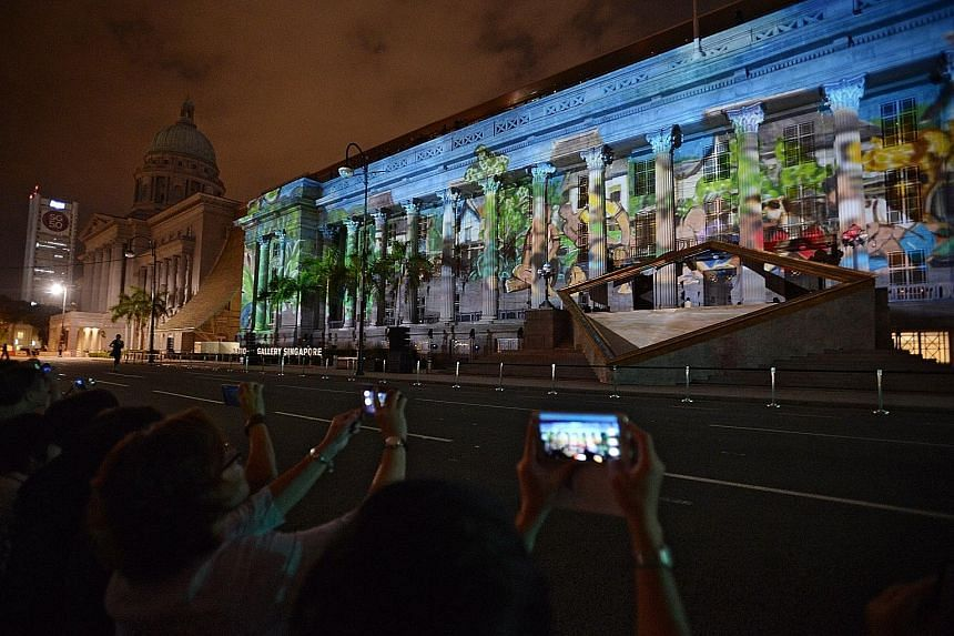 Images being projected onto the facade of the National Gallery Singapore, for the Share the Hope Facade Show, at its grand opening last night. SEE TOP OF THE NEWS A10