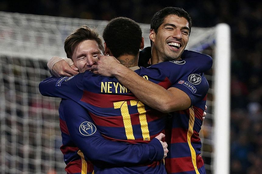 Lionel Messi (left), Neymar and Luis Suarez embrace after Barcelona's fifth goal in the Champions League match against Roma on Nov 24. The form of Cristiano Ronaldo, Zlatan Ibrahimovic and Messi in the Champions League carries a common joy.
