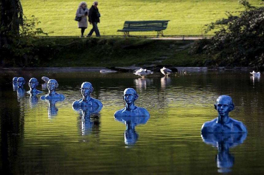 On display at the Montsouris park in Paris is the artwork Where The Tides Ebb And Flow by Argentinian artist Pedro Marzorati. The artist has said that his work represents people already sinking into the sea or who face the threat of being swallowed u