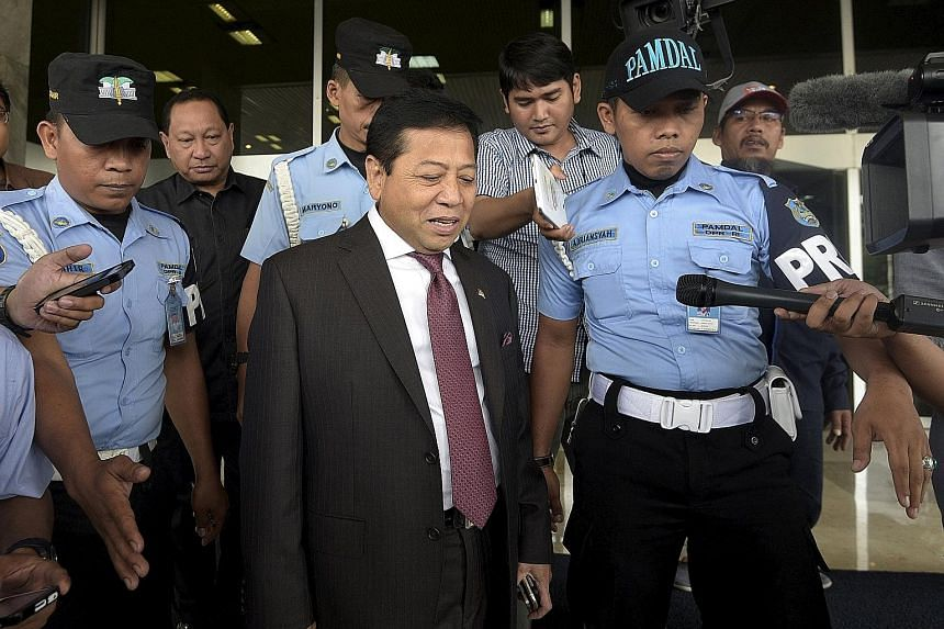 House Speaker Setya Novanto (centre) is accused of attempting to secure shares in Freeport McMoran's Indonesian unit in return for helping the miner extend its contract to operate in Indonesia's Papua province.